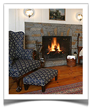 Settle in by the fire at Tuck Inns cozy Rockport, MA Bed and Breakfast.