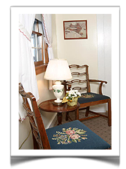 Many of Tuck Inns room accommodations in Rockport, Mass have comfortable sitting nooks inside the guestrooms. This one is located in the Thieme Room.